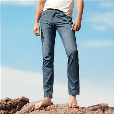 Ultra thin mid rise slim tapered jeans