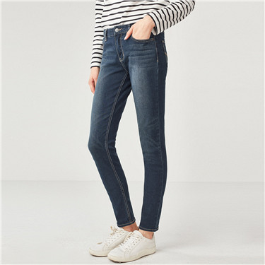 Whiskered mid rise skinny jeans
